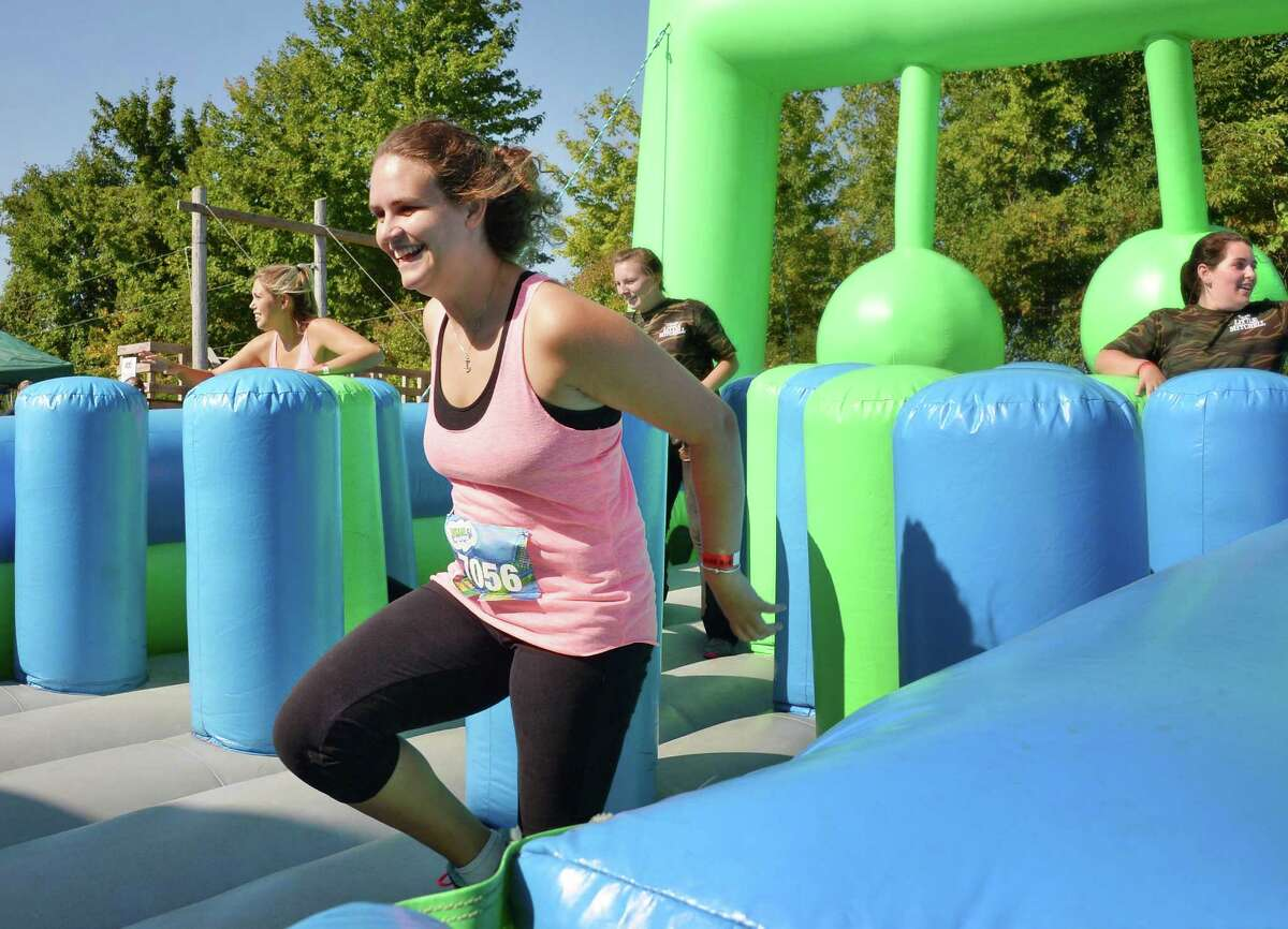 Ansley Chlastawa of Albany participates in the Insane Inflatable 5K Obstacle Fun Run at the Ellms Family Farms Saturday Sept. 5, 2015 in Ballston Spa, NY. (John Carl D'Annibale / Times Union)