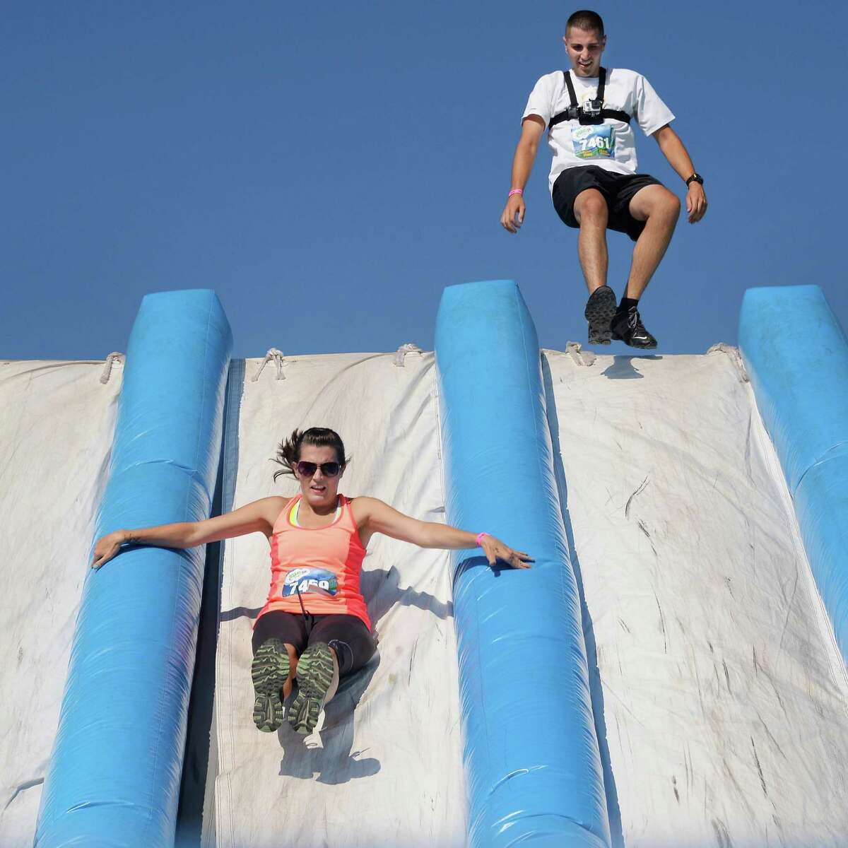 Caitlin Cady, left, and husband Ryan Cady of Schaghticoke finish the Insane Inflatable 5K Obstacle Fun Run at the Ellms Family Farms Saturday Sept. 5, 2015 in Ballston Spa, NY. (John Carl D'Annibale / Times Union)