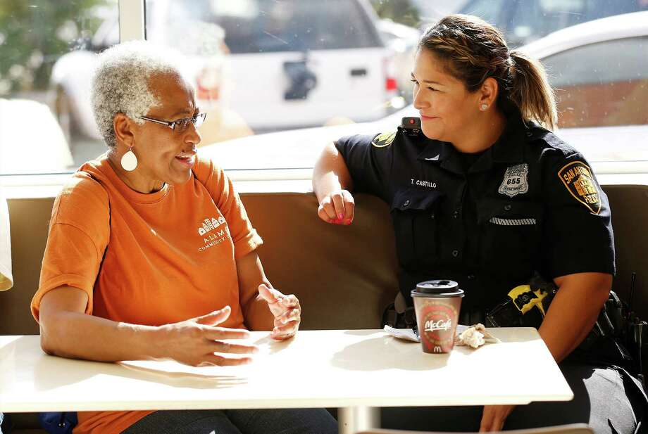 SAFFE Officer Tina Castillo (right) listens to concerns by Pat Kennedy at the Coffee and Cops event held at McDonald's near Walters Street on Saturday, Sept. 5, 2015. Interim Chief of Police Anthony Trevino along with several police officers kicked off the event at McDonald's to discuss various policing topics. Also on hand was Councilman Alan Warrick. (Kin Man Hui/San Antonio Express-News) Photo: Kin Man Hui, Staff / San Antonio Express-News / ©2015 San Antonio Express-News