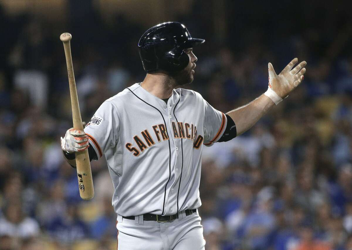 San Francisco Giants' Brandon Belt gestures toward third base umpire Mike Winters after striking out during the eighth inning of a baseball game against the Los Angeles Dodgers, Wednesday, Sept. 2, 2015, in Los Angeles. (AP Photo/Jae C. Hong)