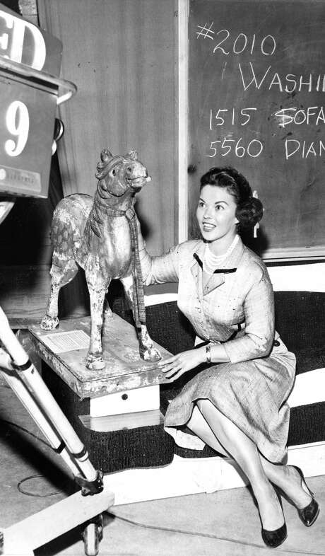 Shirley Temple Black helps auction off a 100-year-old hobby horse during KQED's annual fundraising auction in June 1960. KQED was one of the nation's first public television stations. Photo: Barney Peterson / Barney Peterson / The Chronicle 1960 / ONLINE_YES