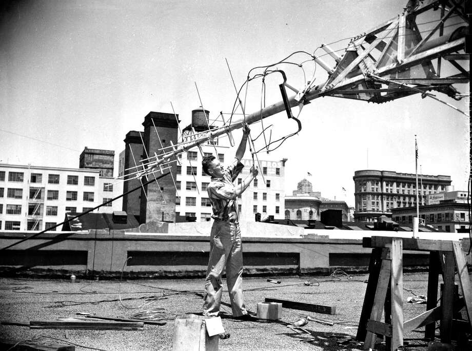 A worker installs an antenna for KRON, a longtime Bay Area leader in news reporting. Photo: Photographer Unknown / Chronicle File Photo / ONLINE_YES