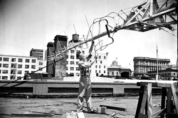 A worker installs an antenna for KRON, a longtime Bay Area leader in news reporting.