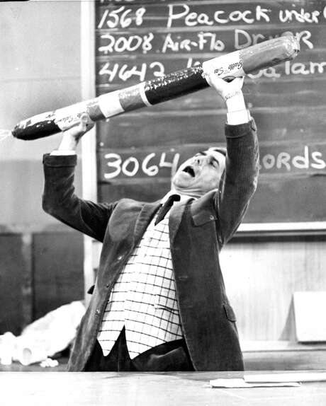 Auctioneer Billy Pearson selling a salami at KQED's annual fundraising auction  in 1961. Photo: Ken McLaughlin / The Chronicle / ONLINE_YES
