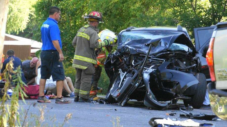 Emergency officials respond to the scene of a collision on Route 20 in Nassau on Saturday, Sept. 5, 2015. (Martin Miller / Special to the Times Union)