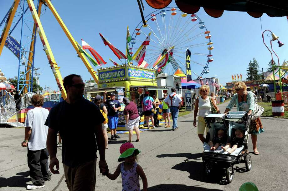 Fairgoers take in the sights of the Schaghticoke Fair on Saturday, Sept. 5, 2015, at the Schaghticoke Fairgrounds in Schaghticoke, N.Y. The fair continues through Monday from 10 a.m. to 10 p.m. Visit www.schaghticokefair.com for more information. (Cindy Schultz / Times Union) Photo: Cindy Schultz / 10032908A