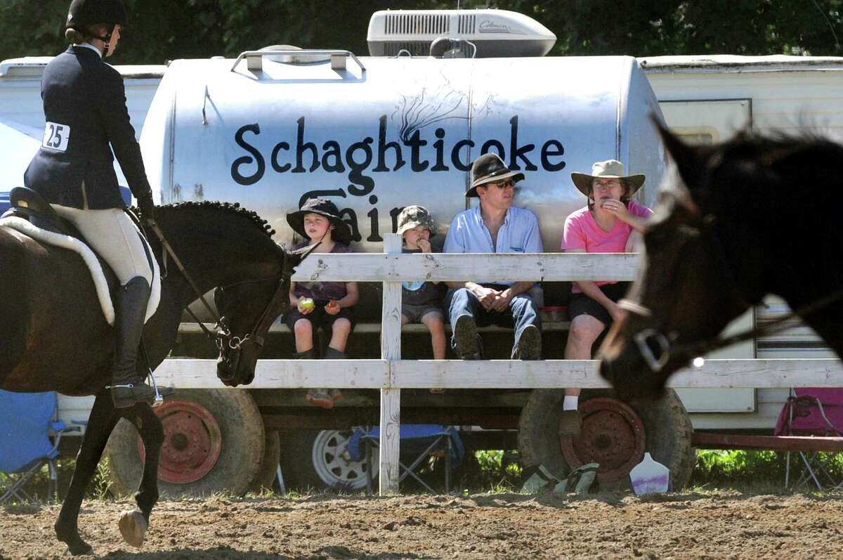 Spectators watch an English horse show during the Schaghticoke Fair on Saturday, Sept. 5, 2015, at the Schaghticoke Fairgrounds in Schaghticoke, N.Y. The fair continues through Monday from 10 a.m. to 10 p.m. Visit www.schaghticokefair.com for more information. (Cindy Schultz / Times Union)