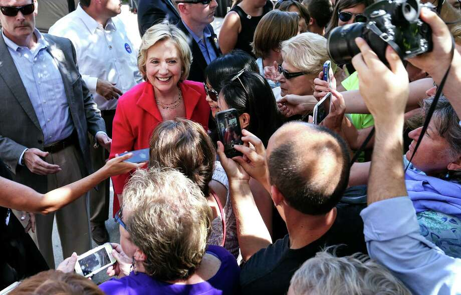 Democratic presidential candidate Hillary Rodham Clinton has pictures taken with supporters as she leaves after being endorsed by Sen. Jeanne Shaheen, D-N.H., during the kick-off event for New Hampshire Women for Hillary in Portsmouth, N.H., Saturday, Sept. 5, 2015. (AP Photo/Cheryl Senter) Photo: Cheryl Senter, FRE / FR62846 AP