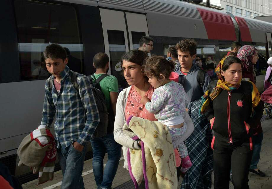 Migrants arrive at the Westbahnhof station in Vienna, Austria, Saturday, Sept. 5, 2015, where they came from Hungary as Austria in the early-morning hours said it and Germany would let them in.  (AP Photo/Hans Punz) ORG XMIT: XPZ104 Photo: Hans Punz / AP