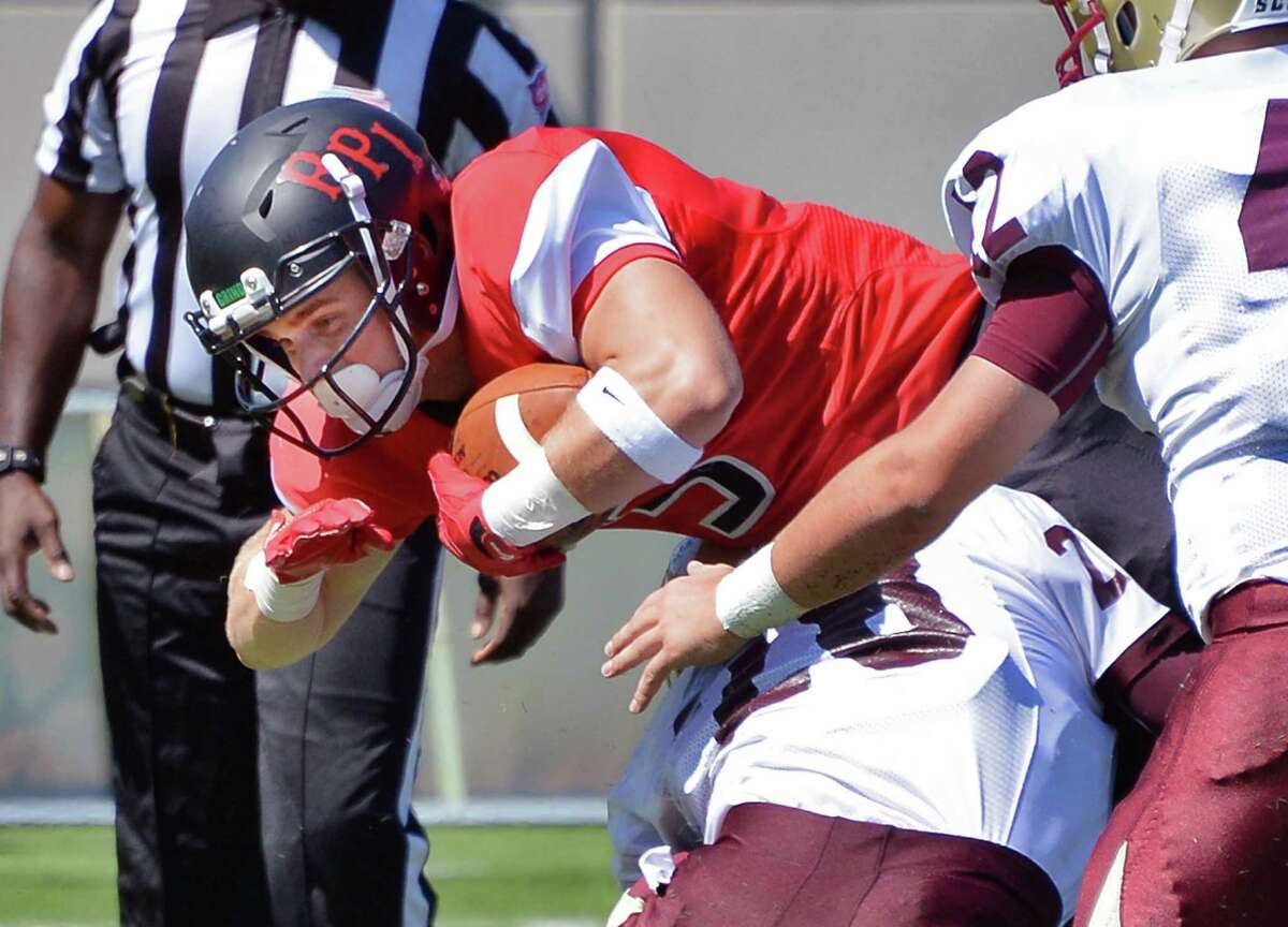 RPI's #5 Nick Esposito crashes through Norwich tackles for extra yardage during Saturday's game at East Campus Stadium Sept. 5, 2015 in Troy, NY. (John Carl D'Annibale / Times Union)