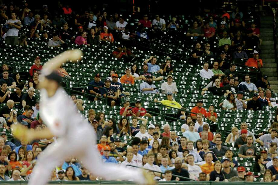 The Astros hosted the Seattle Mariners before a typically sparse midweek crowd on Wednesday. While attendance has been up this year, the team has yet to capture consistently large crowds despite being in a pennant race. Photo: Gary Coronado, Staff / © 2015 Houston Chronicle