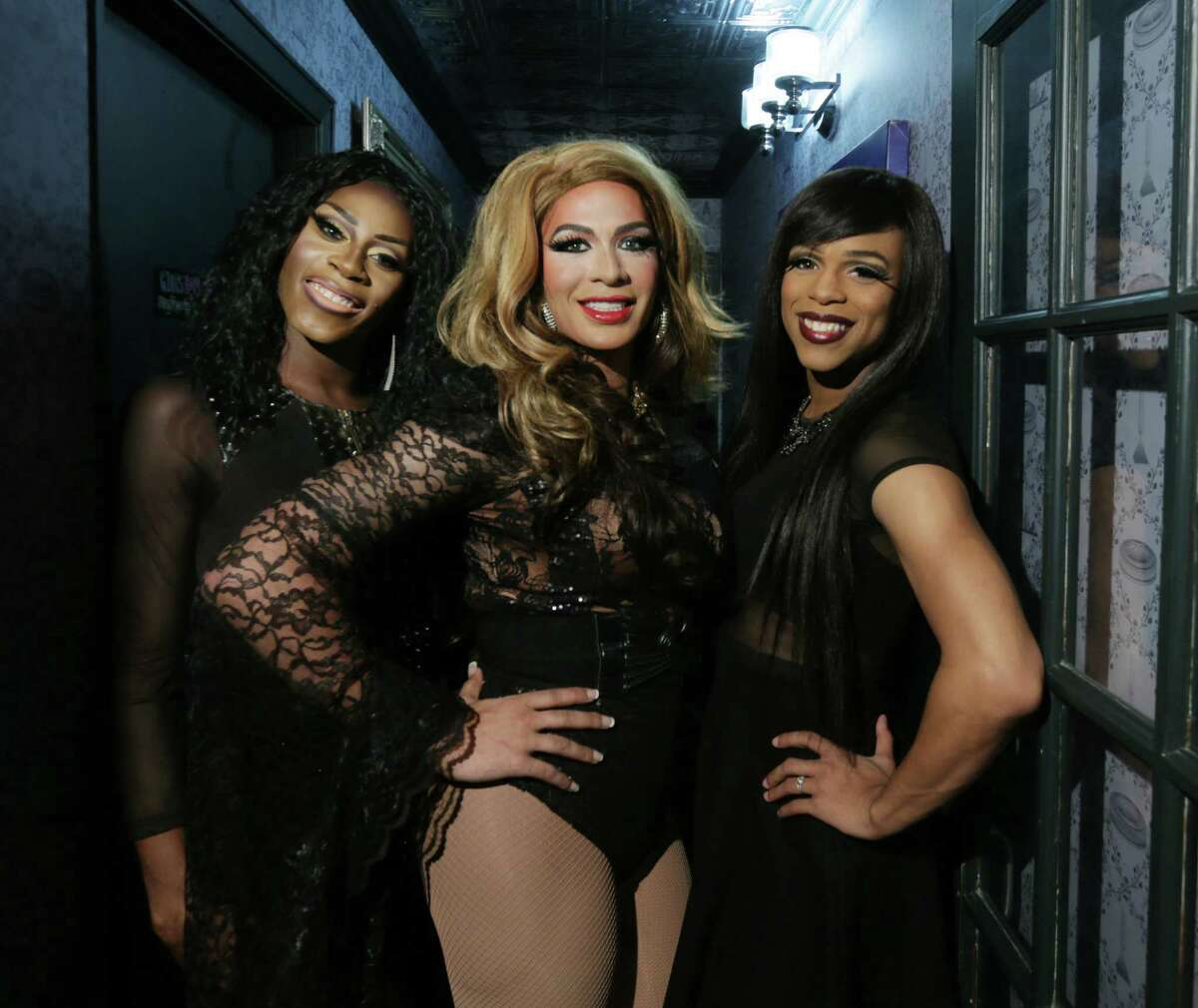 DC Remix pose for a photo at Lowbrow's Lowdown Bey-Day Drag Brunch Saturday, Sept. 5, 2015, in Houston.