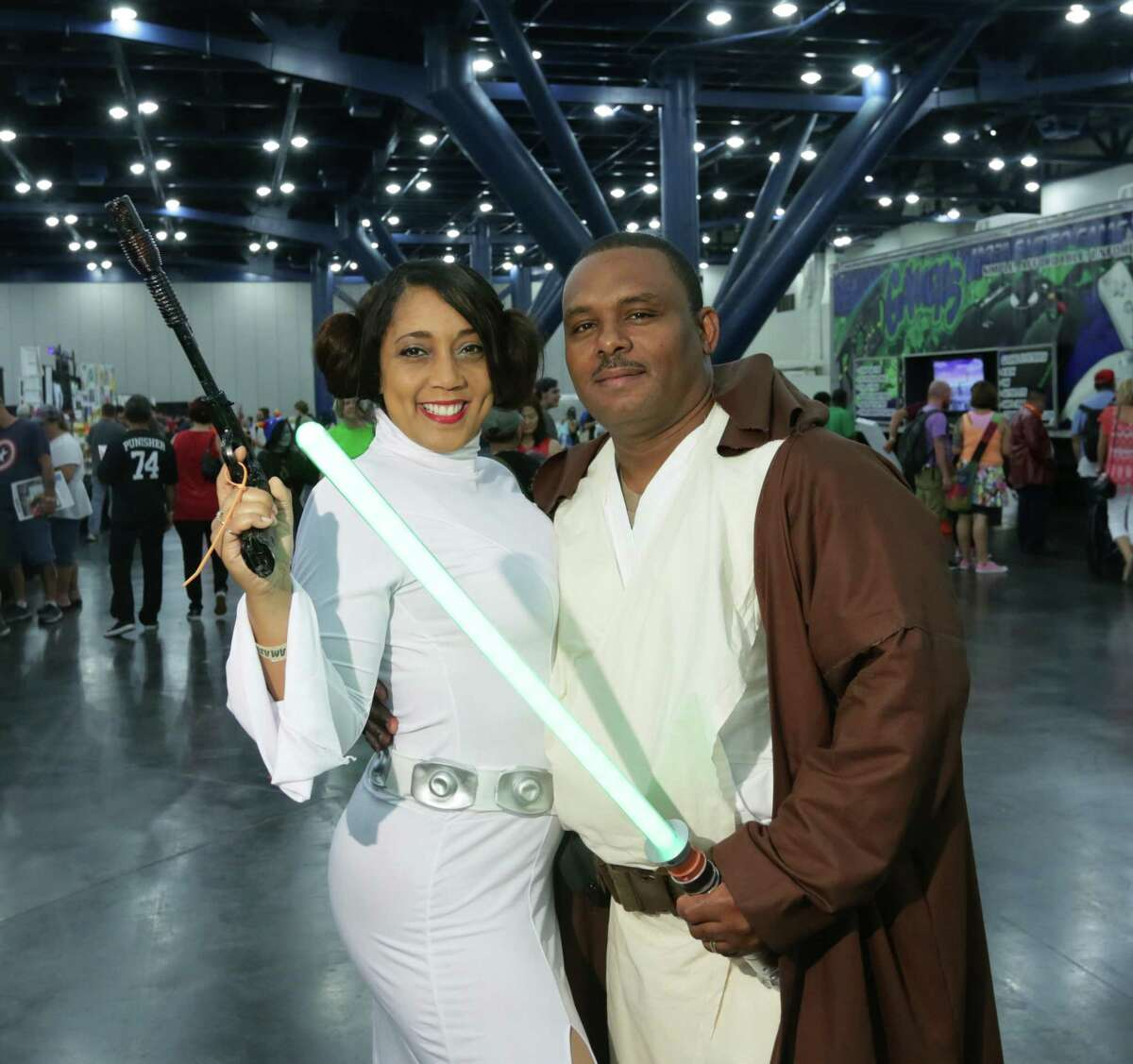 Fans pose for a photo at the Amazing! Houston Comic Con at the George R. Brown convention center, Saturday, Sept. 5, 2015, in Houston.