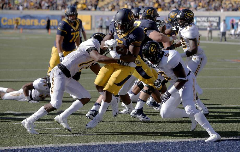 Cal running back Tre Watson, 5 drags a couple of defenders into the end zone for a 4th quarter touchdown run, as the University of California Golden Bears take on the Grambling State Tigers at Memorial Stadium on Sat. September 5, 2015, in Berkeley, Calif. Photo: Michael Macor, The Chronicle