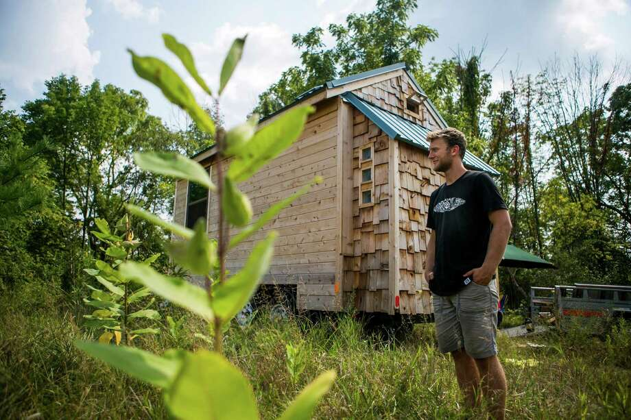 Christopher Cerk, 21, built a 170-square-foot house over the last two years and expects to live in it until his graduation from the University of Michigan. Photo: Dominic Valente, MBI / The Ann Arbor News