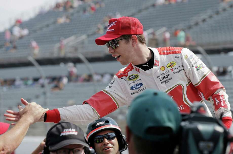 Brad Keselowski is congratulated by crew members after winning the pole for Sundays NASCAR Sprint Cup auto race at Darlington Raceway in Darlington, S.C., Saturday, Sept. 5, 2015. (AP Photo/Terry Renna) ORG XMIT: SCTR104 Photo: Terry Renna / FR60642 AP