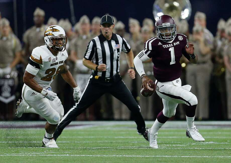 Texas A&M Aggies quarterback Kyler Murray (1) runs the ball against Arizona State Sun Devils defensive back Lloyd Carrington (8) during the first half of a college football game during the Advocare Texas Kickoff game at NRG Stadium on Saturday, Sept. 5, 2015. Photo: Karen Warren, Houston Chronicle / © 2015 Houston Chronicle