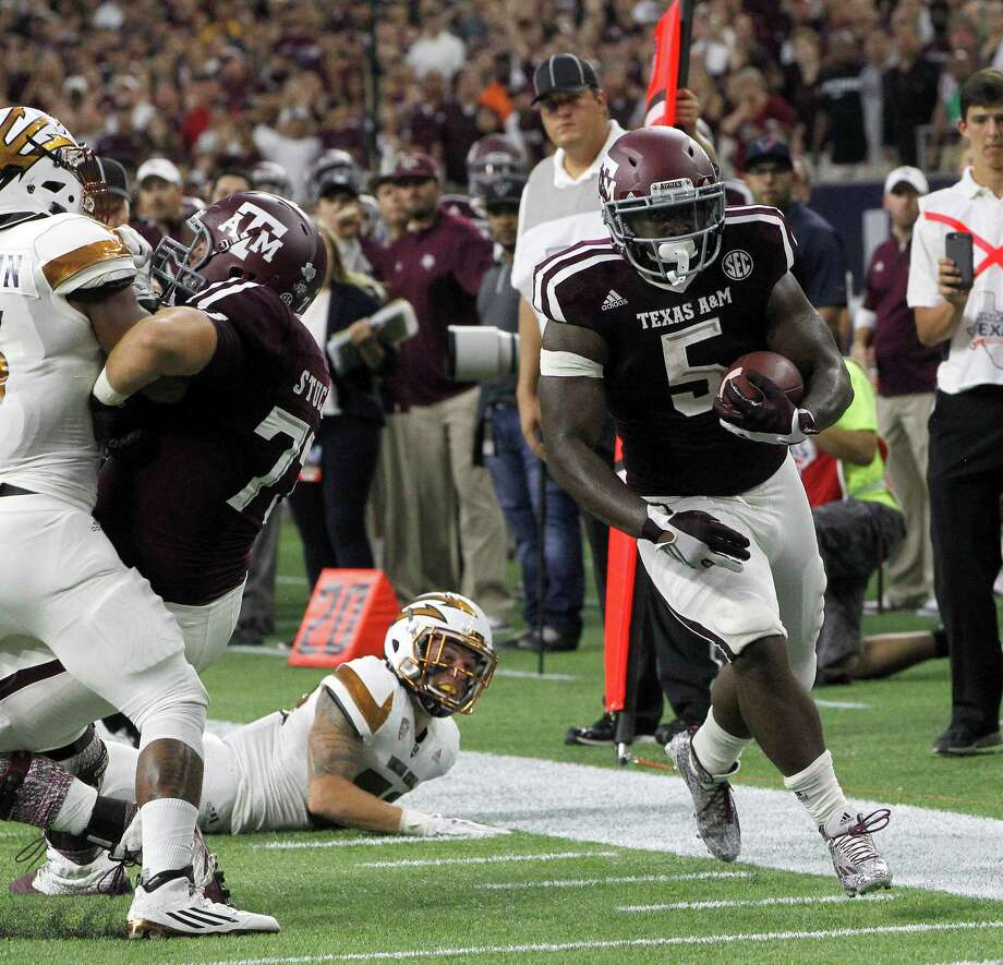 Tra Carson (5) and Texas A&M were impressive enough in their season-opening win over Arizona State to vault into the AP top 25 poll.Click through the gallery to see this week's rankings. Photo: Karen Warren, Houston Chronicle / © 2015 Houston Chronicle
