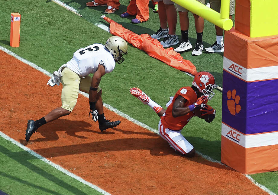 Clemson's Mike Williams pays the price for a touchdown reception, crashing into the goal post and suffering a neck injury. He was carted off the field but had returned to the sideline in a neck brace by the fourth quarter. Photo: Rainier Ehrhardt, FRE / FR155191 AP
