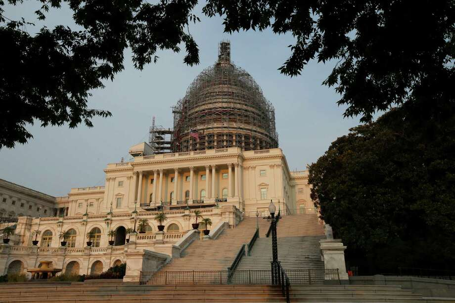 The west front of the U.S. Capitol is seen under repair Sept. 2, 2015 in Washington. Congress returns on Sept. 8 with a critical need for a characteristic that has been rare through a contentious spring and summer _ cooperation between Republicans and President Barack Obama. Lawmakers face a weighty list of unfinished business and looming deadlines, with a stopgap spending bill to keep the government open on Oct. 1 paramount. (AP Photo/Alex Brandon) Photo: Alex Brandon, STF / AP