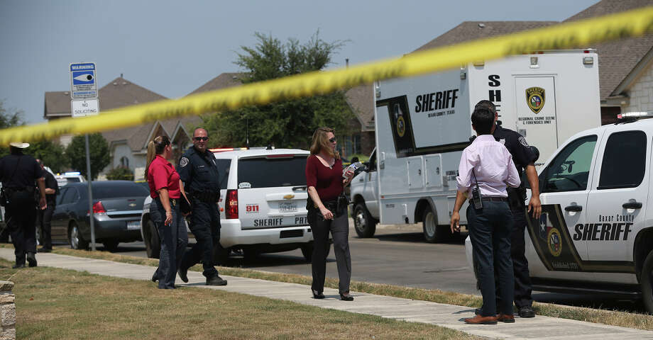 Bexar County sheriff's officials investigate the scene in the Walnut Pass neighborhood where deputies shot a man as they responded to a domestic disturbance call. Photo: John Davenport / San Antonio Express-News / The San Antonio Express-News