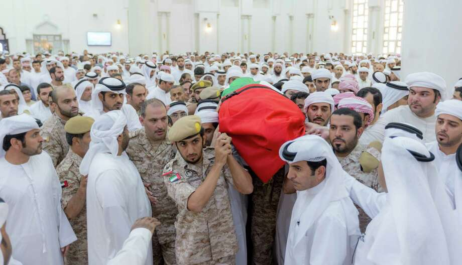 Abdullah Ali Hassan Al-Hammadi, one of dozens of troops killed in a missile strike in Yemen, is carried at his funeral in Ajman, United Arab Emirates. Photo: Emerates News Agency /Associated Press / WAM