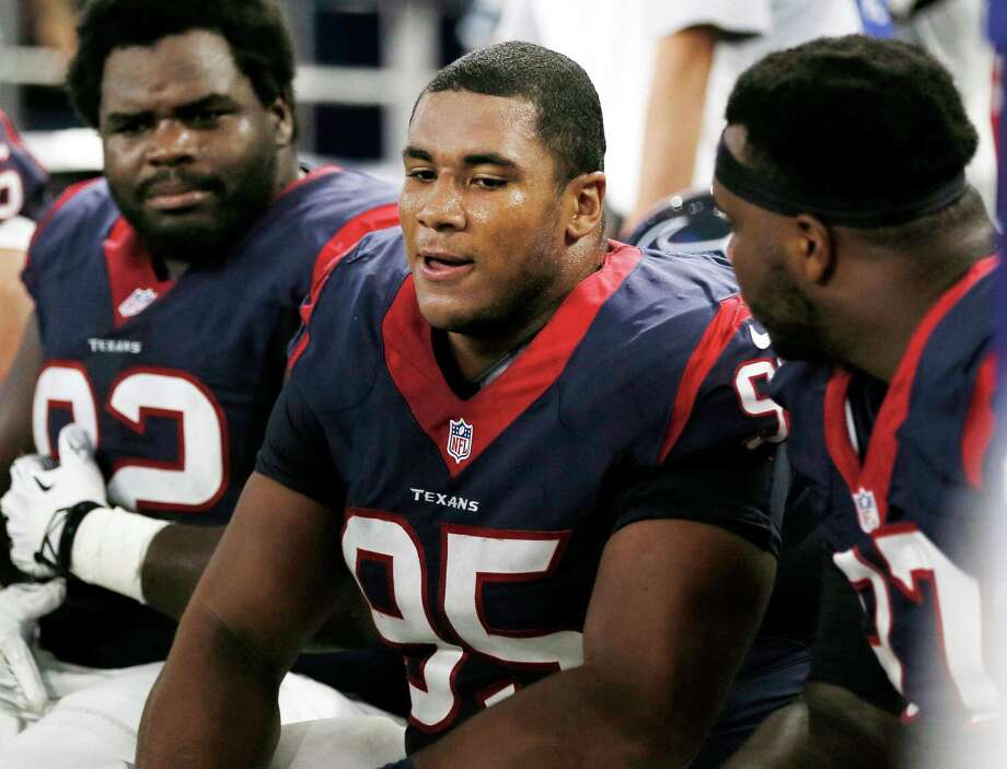 "Defensive tackle Christian Covington (center) said it was a ""dream come true"" to make the Texans' roster. Photo: Brandon Wade /Associated Press / FR168019 AP"