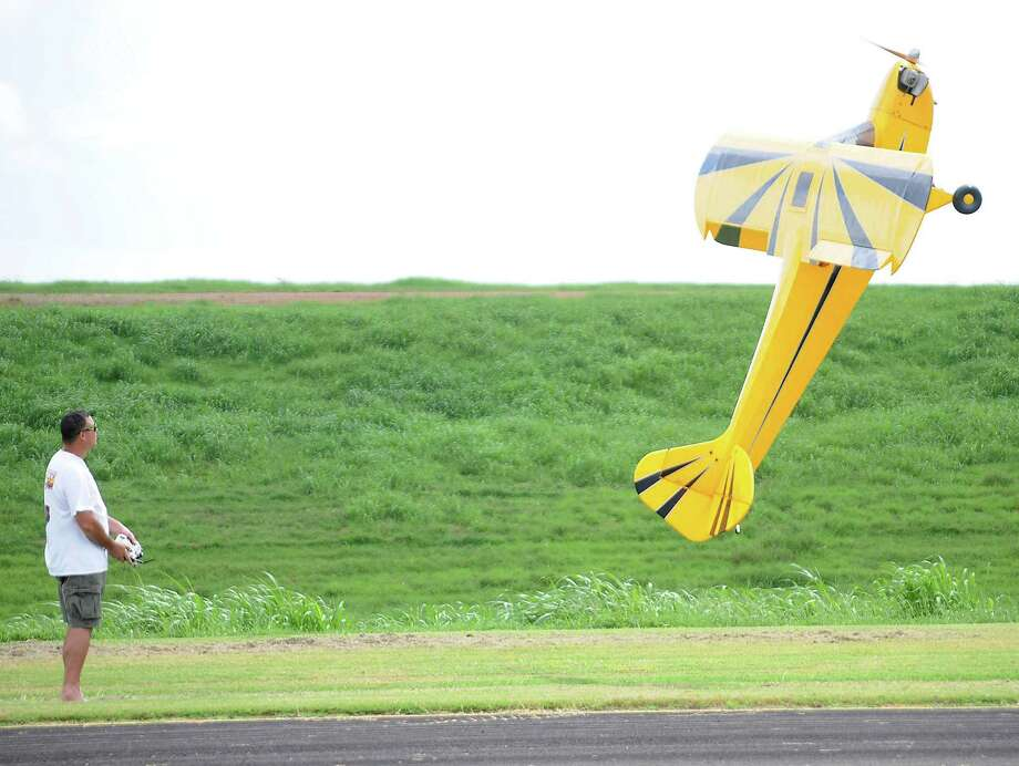 Robert Bernal of Pearland flies his 1/2 scale Cub aircraft during the 17th Annual Model Air Show and Model Aircraft Fly-In at the Ft. Bend County R/C Club's flying field Saturday Sept. 5,2015.(Dave Rossman photo) Photo: Dave Rossman, Freelance / Freelalnce