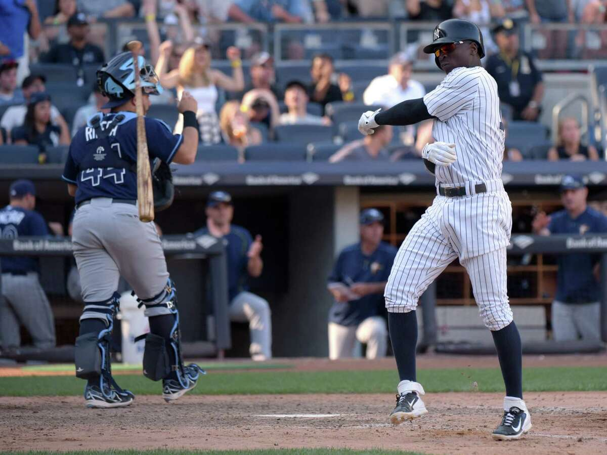 New York Yankees' Didi Gregorius, right, throws his bat after lining out with bases loaded to end the eighth inning as Tampa Bay Rays catcher Rene Rivera heads to the dugout during a baseball game Saturday, Sept. 5, 2015, at Yankee Stadium in New York. (AP Photo/Bill Kostroun) ORG XMIT: NYY110
