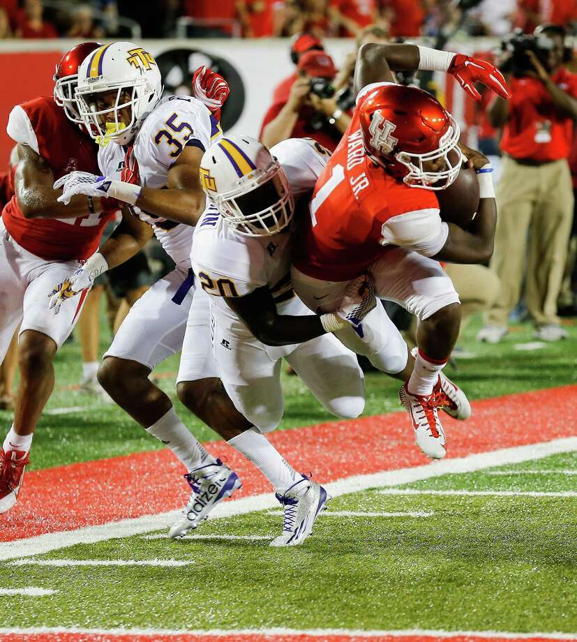 HOUSTON, TX - SEPTEMBER 05:  Greg Ward Jr. #1 of the Houston Cougars dives for a touchdown in the second quarter as Johnnie Anderson #20 of the Tennessee Tech Golden Eagles attempts the tackle during the game at TDECU Stadium on September 5, 2015 in Houston, Texas.  (Photo by Bob Levey/Getty Images) Photo: Bob Levey, Stringer / 2015 Getty Images