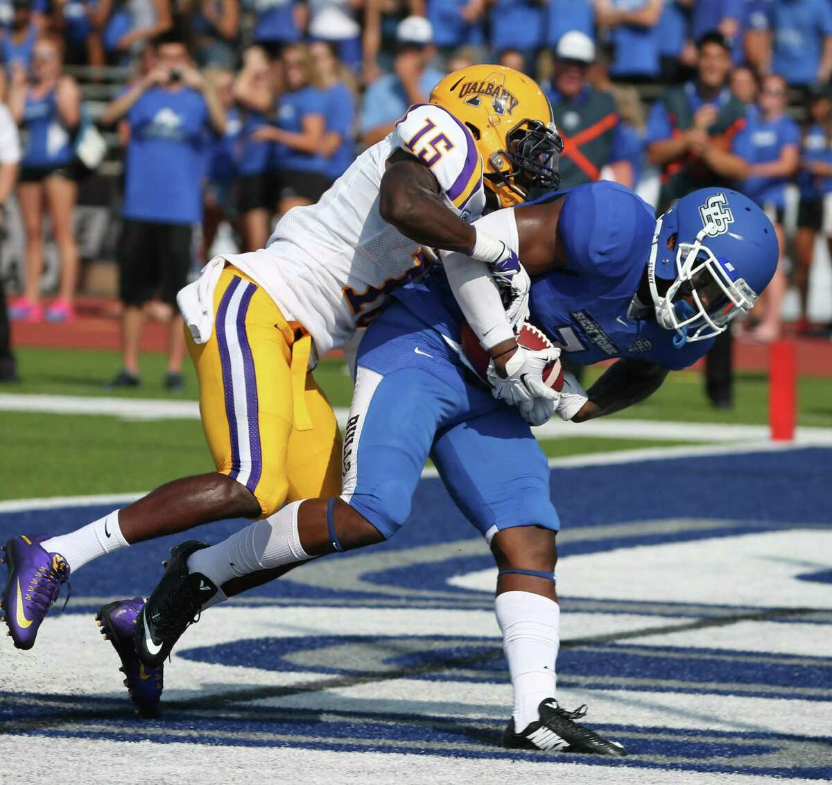 Buffalo wide receiver Marcus McGill (7) beats UAlbany safety Rayshan Clark (15) for a first down in the first quarter at Universitiy at Buffalo Stadium in Amherst, N.Y., on Saturday, Sept. 5, 2015. (James P. McCoy/ Buffalo News)