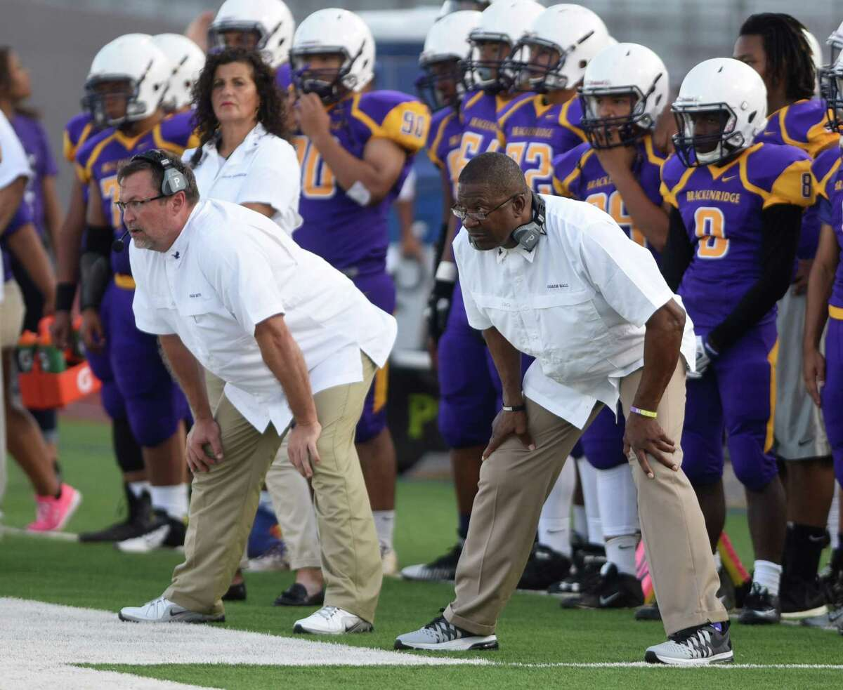 Brackenridge football coach Willie Hall, right, watches his team in action against Devine during high school football action at Alamo Stadium on Sept. 5, 2015.