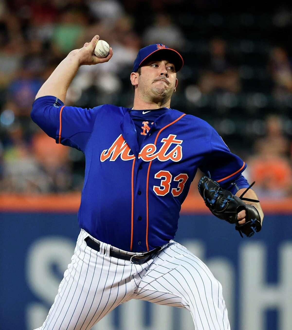 New York Mets starting pitcher Matt Harvey throws against the Philadelphia Phillies during the first inning of a baseball game Wednesday, Sept. 2, 2015, in New York. (AP Photo/Kathy Kmonicek) ORG XMIT: NYM104