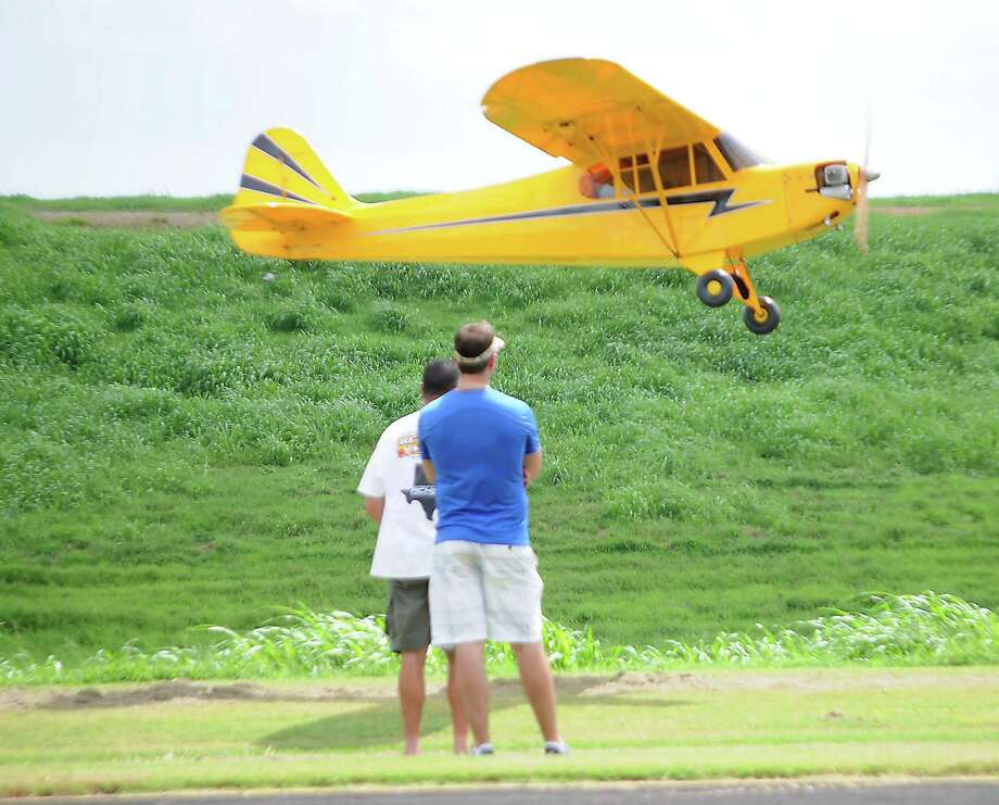 Robert Bernal of Pearland flies his 1/2 scale Cub aircraft during the 17th Annual Model Air Show and Model Aircraft Fly-In at the Ft. Bend County R/C Club's flying field Saturday Sept. 5,2015. Photo: Dave Rossman, For The Chronicle / Freelalnce