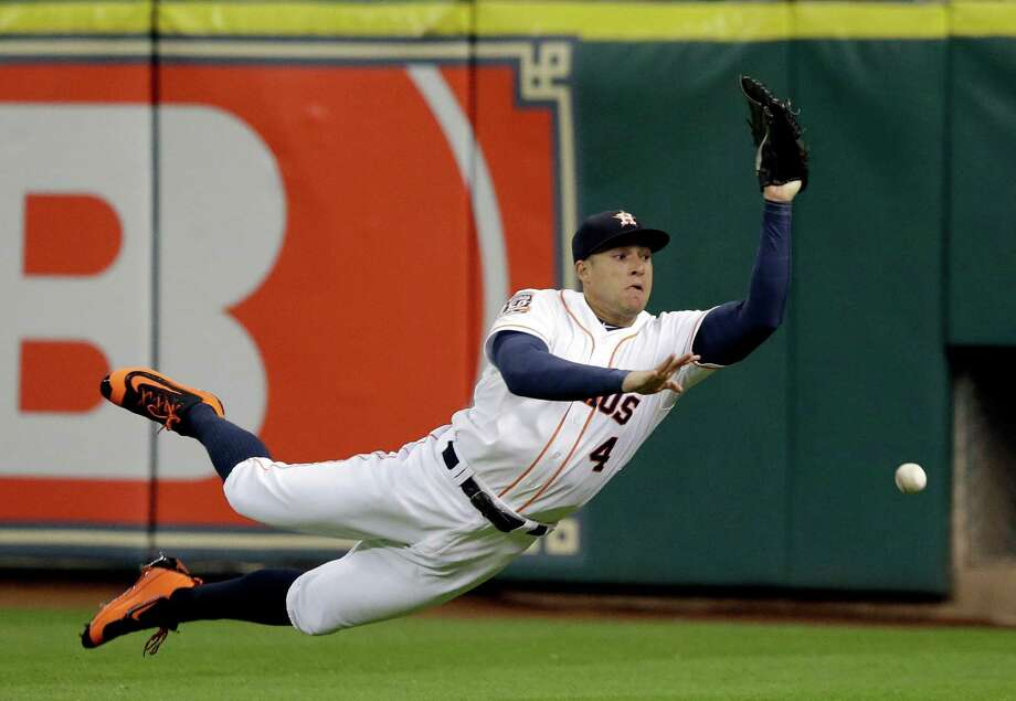 Astros right fielder George Springer has the ball bounce off his glove on what turned out to be a decisive two-run triple for the Twins' Eddie Rosario in the ninth inning. Photo: Pat Sullivan, STF / AP