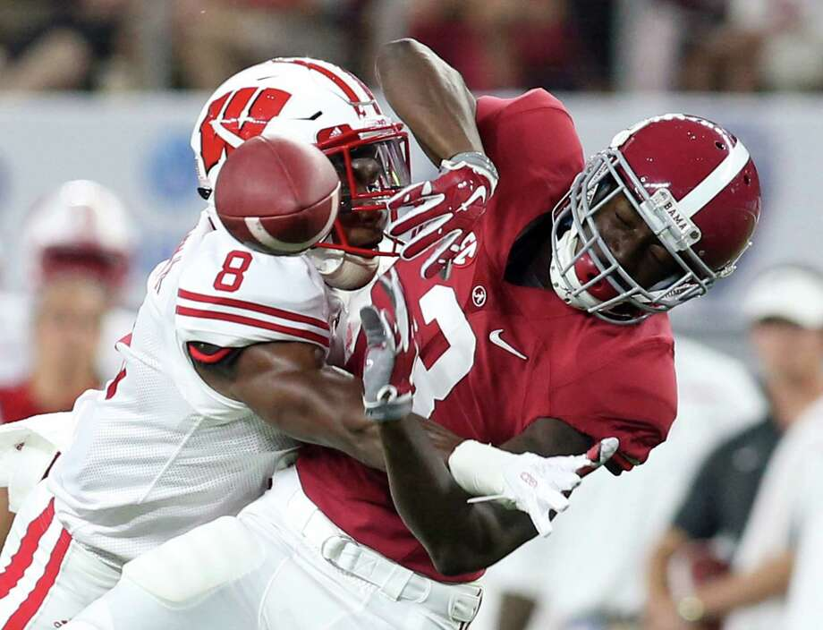 Wisconsin cornerback Sojourn Shelton (8) breaks up a pass intended for Alabama wide receiver Calvin Ridley (3) in the first quarter at the Advocare Classic at AT&T Stadium Saturday, Sept. 5, 2015 in Arlington, Texas. Albama beat Wisconsin 35-17. (Richard W. Rodriguez/Fort Worth Star-Telegram/TNS) Photo: Richard W. Rodriguez, MBR / McClatchy-Tribune News Service / Fort Worth Star-Telegram