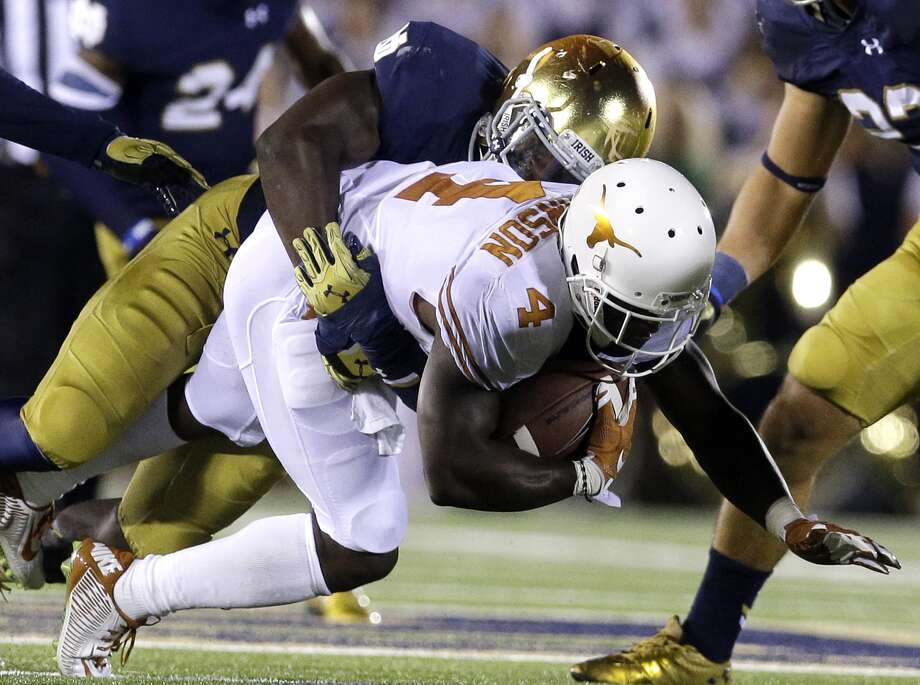 Texas wide receiver Daje Johnson, bottom, is tackled by Notre Dame linebacker Te'von Coney during the second half of an NCAA college football game Saturday, Sept. 5, 2015, in South Bend, Ind. Notre Dame won 38-3. Photo: Nam Y. Huh /Associated Press / AP