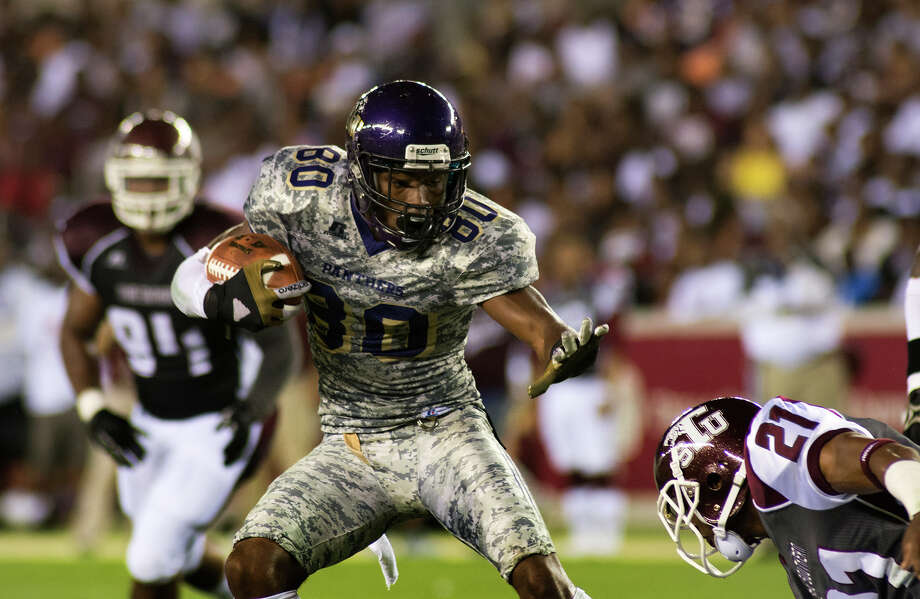 Prairie View receiver Rayshaun Givins tries to fend off Texas Southern's Demetrius Johnson (21) during the Labor Day Classic at BBVA Compass Stadium. Photo: Jerry Baker, Freelance