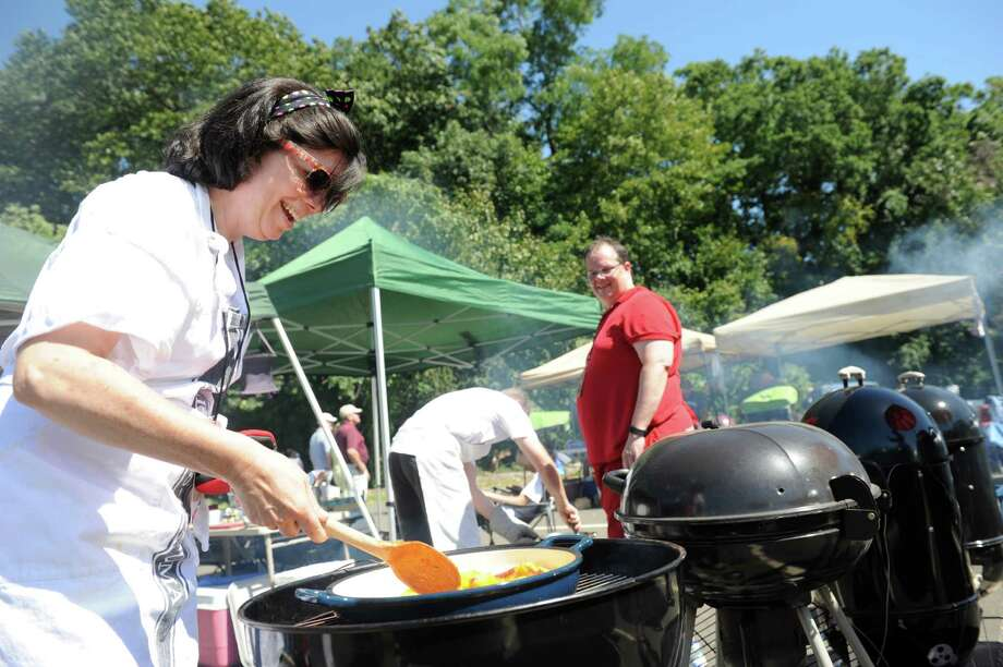 "Lynn Goodwin, of Norwalk, carmelizes peaches on the grill for her team ""Psycho Grillers'"" desert entry Saturday, Sept. 5, 2015, during the Blues Views & BBQ Festival in Westport, Conn. The event continues Sunday from 11 a.m. to 9 p.m. on the grounds of Levitt Pavillion and the Westport Library. Photo: Autumn Driscoll / Hearst Connecticut Media / Connecticut Post"