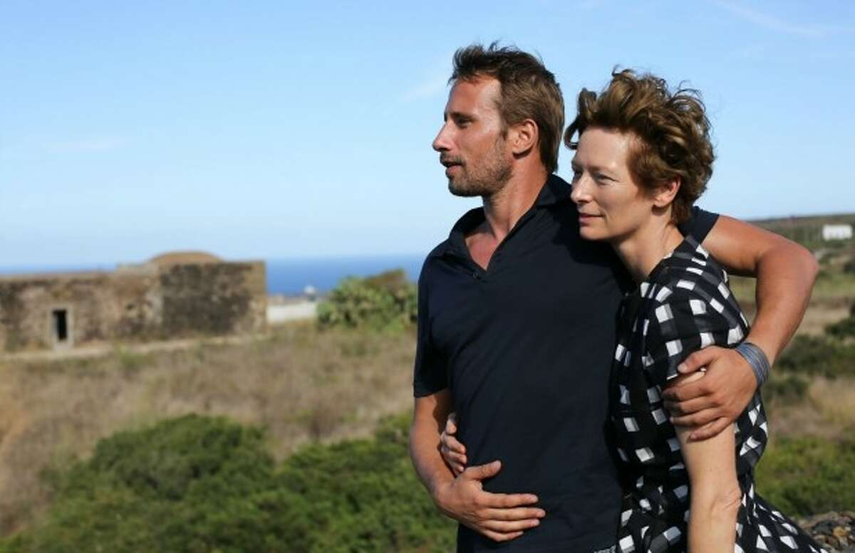 A Bigger Splash coming May 6. The vacation of a famous rock star and a filmmaker is disrupted by the unexpected visit of an old friend and his daughter. Starring Tilda Swinton, Matthias Schoenaerts, Ralph Fiennes, Dakota Johnson.
