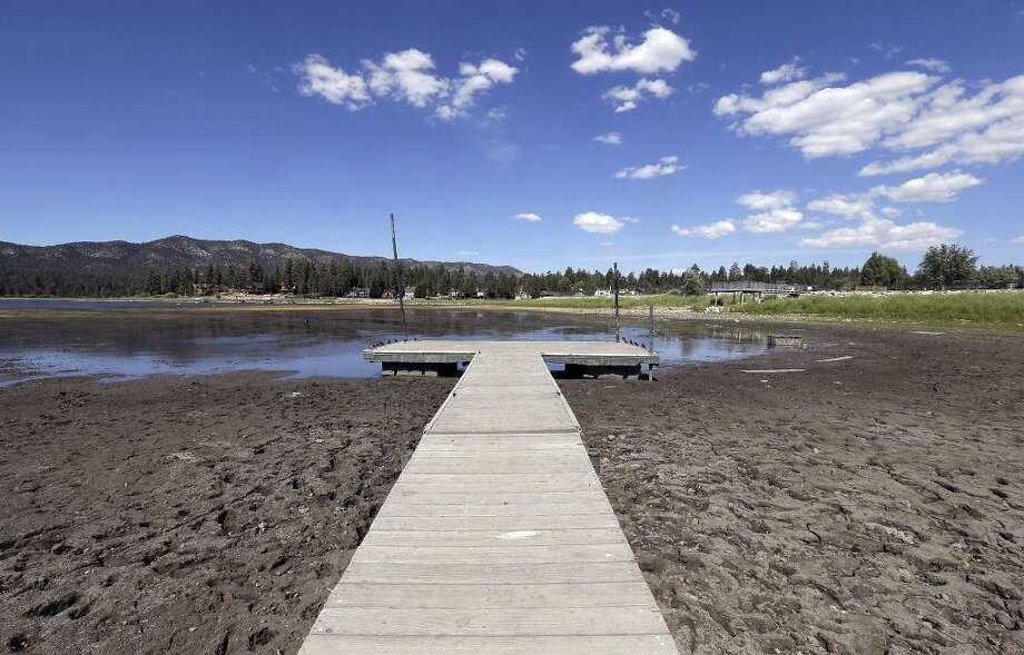 Things are looking especially dry at Big Bear Lake in California, as seen in this Aug. 24, 2015, photo. California cities cut water use by a combined 31 percent in July, exceeding the governor's statewide mandate to conserve, officials said Thursday, Aug. 27. The strong water conservation figures show California residents are beginning to understand the dire need to cut back in a fourth year of drought, Felicia Marcus, chair of the State Water Resources Control Board, said. Photo: Nick Ut, Associated Press