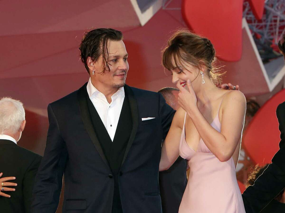 Johnny Depp and Dakota Johnson attend a premiere for 'Black Mass' during the 72nd Venice Film Festival on September 4, 2015 in Venice, Italy. (Photo by Elisabetta A. Villa/WireImage)