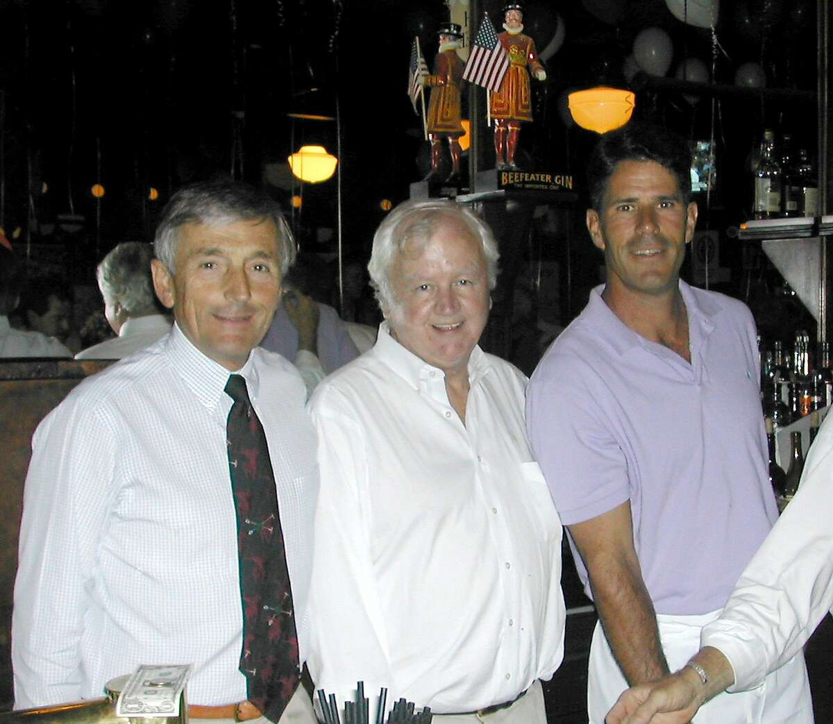 Michael McCourt, center, stands in this 2004 photo with Perry Butler and Steve Bono.