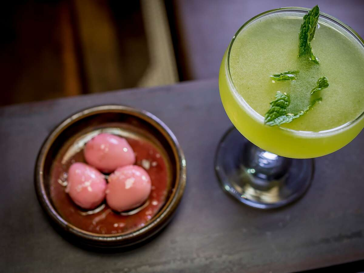 The pickled quail eggs with the Southern Exposure cocktail at the Alembic.