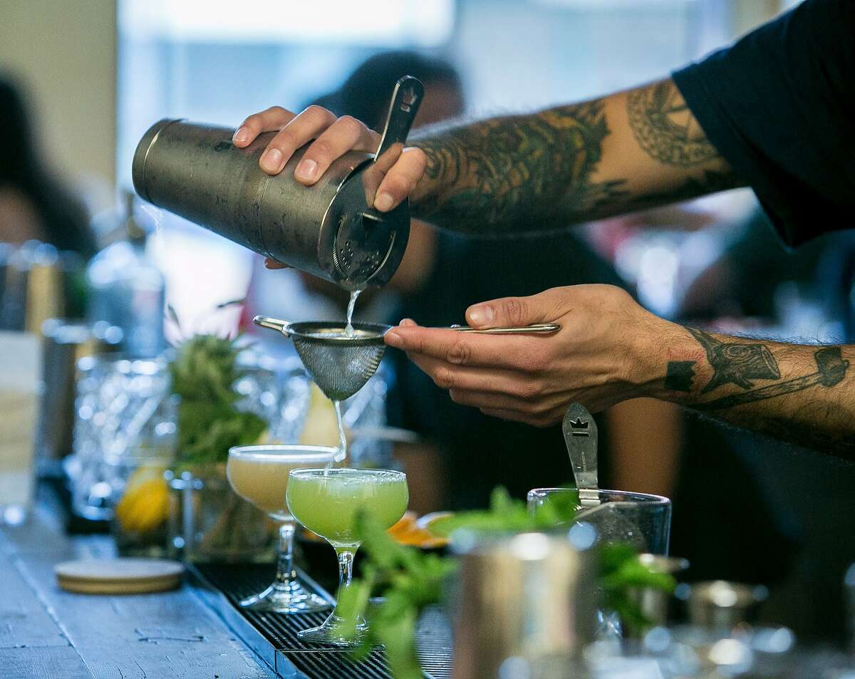 Bartender Hector Valencia makes the Corpse Reviver #2 cocktail at Alembic in San Francisco, Calif., on September 5th, 2015.