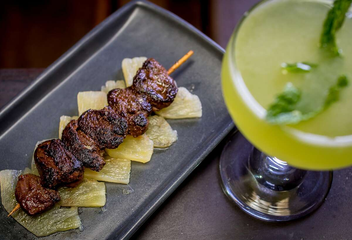 The signature jerk spiced duck hearts with the