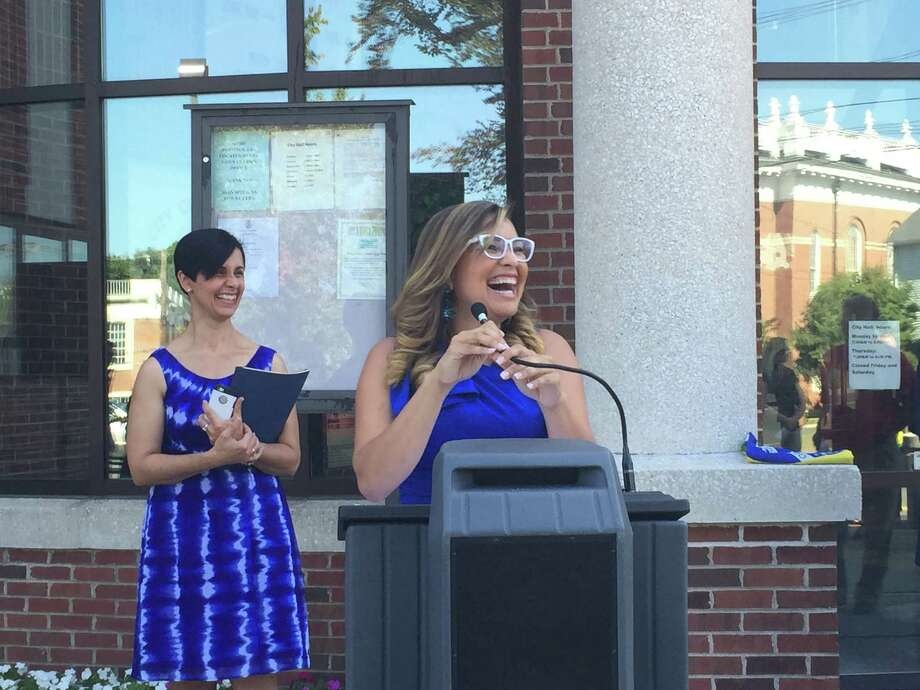 Emanuela Palmares, the master of ceremonies, addresses the crowd outside of Danbury City Hall on Sunday, Sept. 6, 2015. The ceremony was a celebration of Brazil's Independence Day. Photo: Katrina Koerting / Hearst Connecticut Media