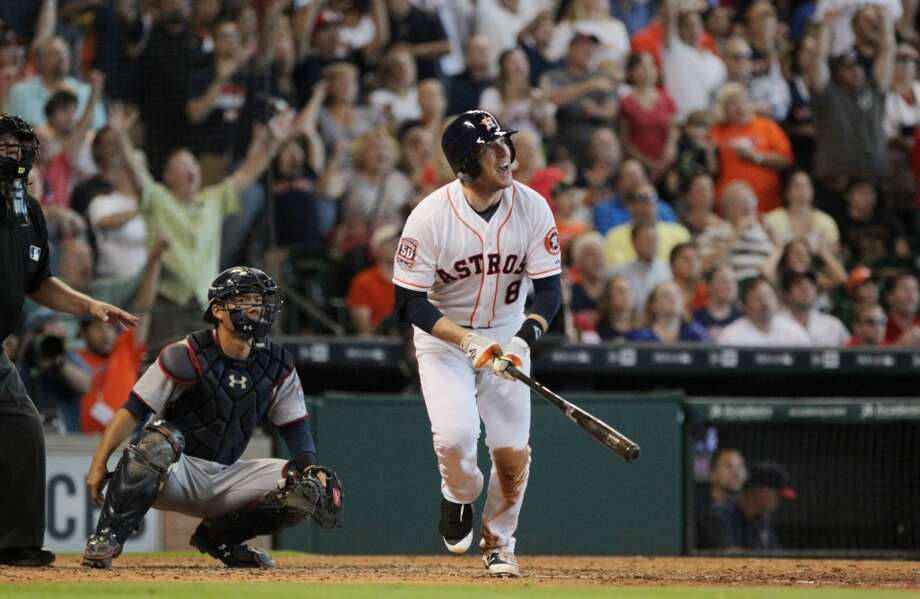 Houston Astros third baseman Jed Lowrie reacts after hitting a grand slam Sunday against the Minnesota Twins. Photo: Houston Chronicle