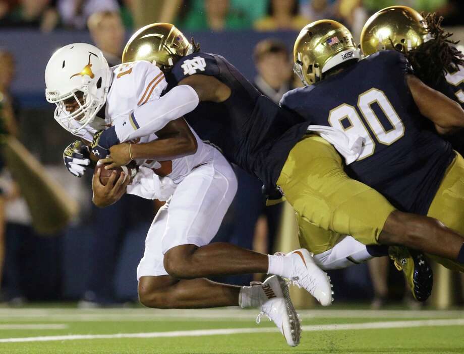 Notre Dame linebacker Jaylon Smith, center, sacks Texas quarterback Jerrod Heard, left, during the first half of an NCAA college football game Saturday, Sept. 5, 2015, in South Bend, Ind. Photo: Nam Y. Huh /Associated Press / AP