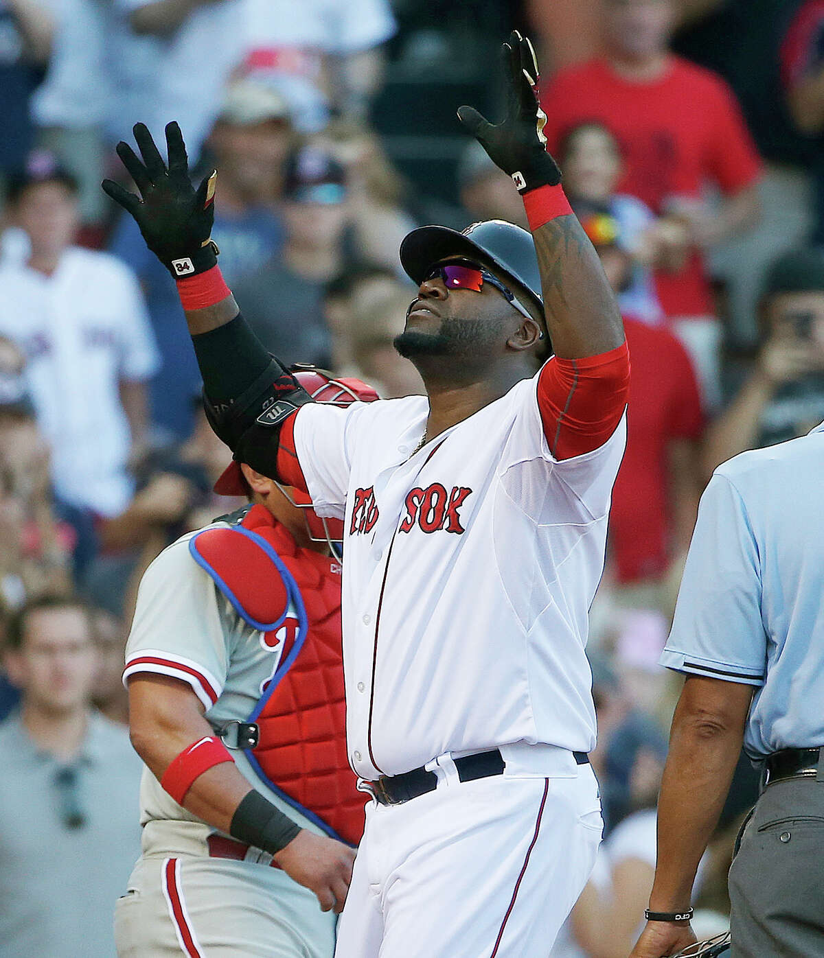 Boston Red Sox's David Ortiz celebrates his solo home run during the fourth inning of a baseball game against the Philadelphia Phillies in Boston, Saturday, Sept. 5, 2015. (AP Photo/Michael Dwyer) ORG XMIT: MAMD107